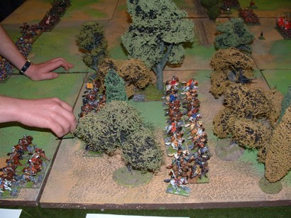 Royalist troops advance through the woods